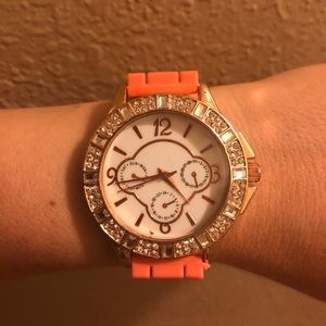 Ladies silicon watch orange band rose gold case